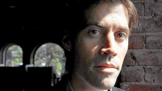 Việc hành quyết nhà báo Foley có thể không đơn giản là ép Mỹ chấm dứt không kích ở Iraq. Ảnh: AP