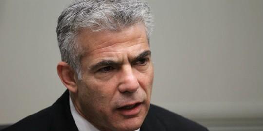 Bộ trưởng Tài chính Yair Lapid cho rằng cuộc bầu cử sớm là không cần thiết. Ảnh: Breaking Israel News