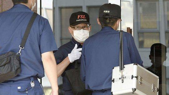 Các nhân viên điều tra phát hiện xác nạn nhân trong nhà hung thủ. Ảnh: AAP