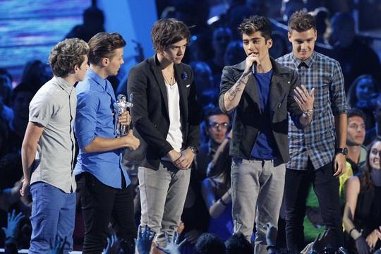 One Direction chiếm cả 5 vị trí trong tốp 10 nghệ sĩ Anh dưới 30 tuổi giàu có nhất. Ảnh: Reuters