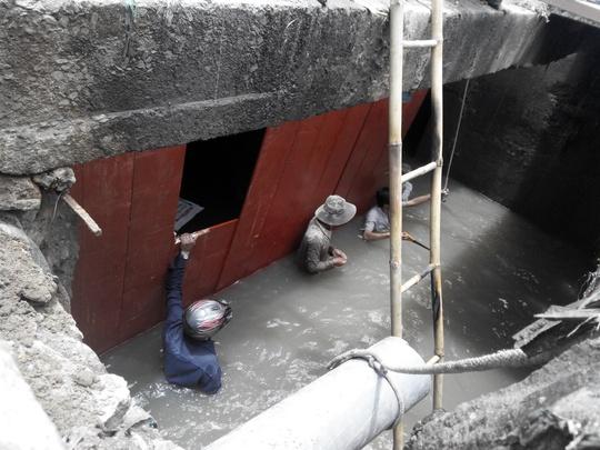 Đóng cửa dòng chảy trong cống
