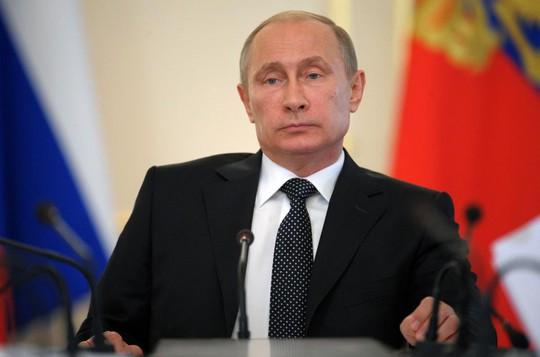 Tổng thống Nga Vladimir Putin giảm giá khí đốt cho Ukraine. Ảnh: AP