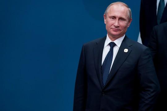 Tổng thống Nga là lãnh đạo đầu tiên rời G20. Ảnh: Bloomberg