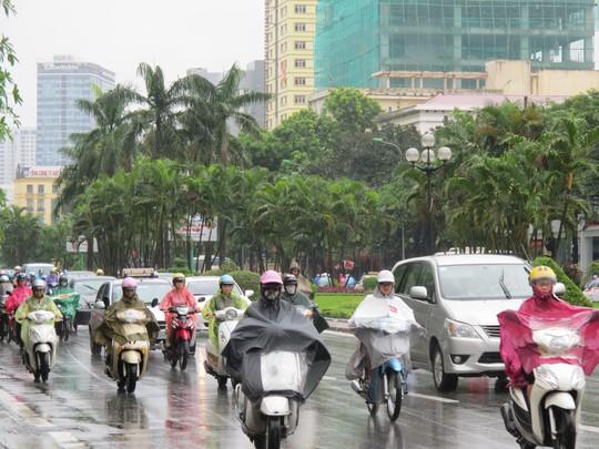 Không khí lạnh tăng cường, cộng với mưa trên diện rộng đã khiến cả miền Bắc chìm trong giá buốt. Ảnh: Văn Duẩn