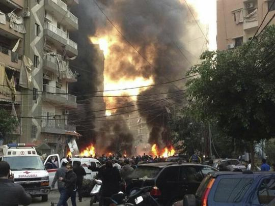 Fire and smoke is seen at the site of the explosion in Beirut's southern suburbs
