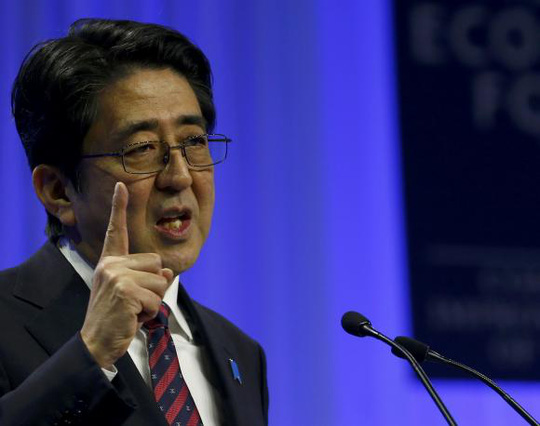 Japans Prime Minister Shinzo Abe addresses a session at the annual meeting of the WEF in Davos January 22, 2014. REUTERS/Denis Balibouse
