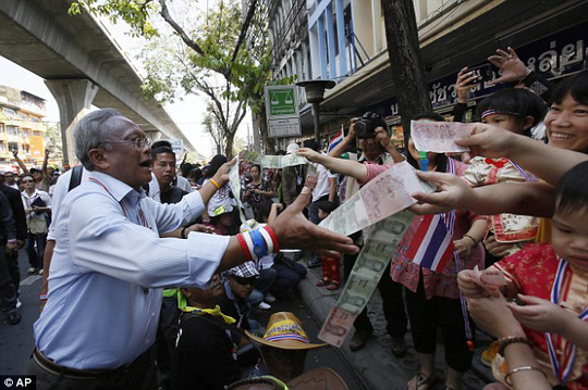 Support: Protest leader Suthep Thaugsuban collects donations during a march through Bangkok today
