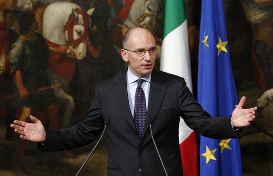 Italian Prime Minister Enrico Letta gestures during a news conference at Chigi Palace in Rome February 12, 2014. REUTERS-Remo Casilli