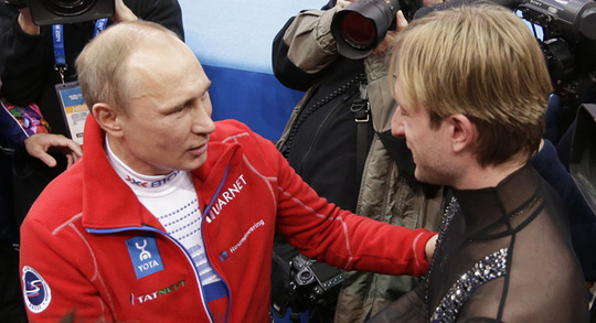 Russian President Vladimir Putin (left) shakes hands with Evgeni Plushenko of Russia during the 2014 Winter Olympics, Feb. 9, in Sochi, Russia. | AP Photo