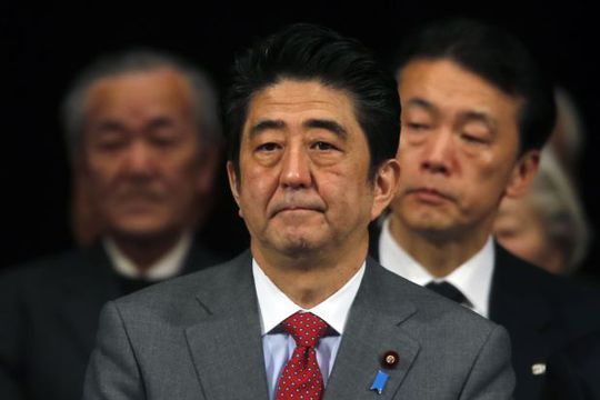 Japans Prime Minister Shinzo Abe (C) attends a Northern Territories Day rally in Tokyo February 7, 2014. REUTERS/Yuya Shino