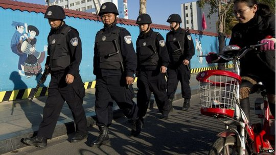 Armed policemen patrol on a street near the Kunming Railway Station in western Chinas Yunnan province, 3 March 2014