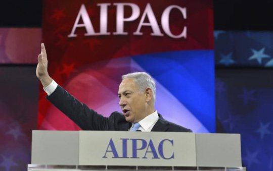 Israeli Prime Minister Benjamin Netanyahu acknowledges applause as he arrives to address the American Israel Public Affairs Committee (AIPAC), in Washington, March 4, 2014. REUTERS/Mike Theiler