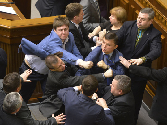 Communist lawmakers scuffle with right-wing Svoboda ( Freedom) Party lawmakers during a parliament session of Verkhovna Rada, the Ukrainian parliament, in Kiev, Ukraine Tuesday, April 8, 2014