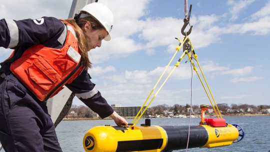 A submarine built by Bluefin Robotics is lowered into the water on Wednesday. Bluefin Robotics shipped a version of their submarine to help locate the missing Malaysian Airlines Flight 370, by using its side-scan sonar.