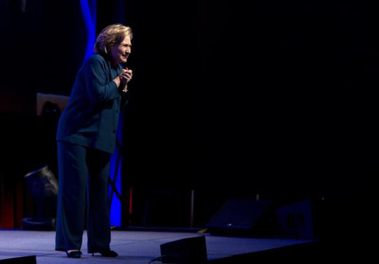 Former U.S. Secretary of State Hillary Clinton looks towards the audience, after someone threw an object onstage, during her speech to members of the Institute of Scrap Recycling Industries in Las Vegas, Nevada April 10, 2014. REUTERS-Las Vegas Sun-Steve Marcus