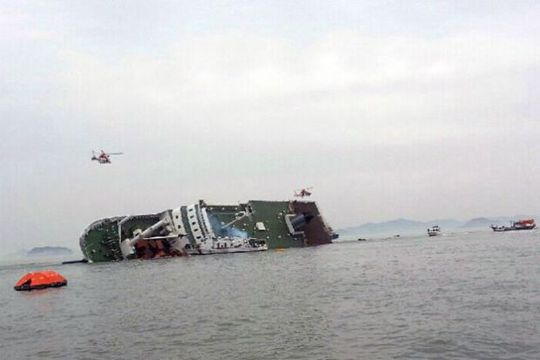 A South Korean passenger ship that has been sinking is seen at the sea off Jindo on Wednesday. -REUTERS/Yonhap