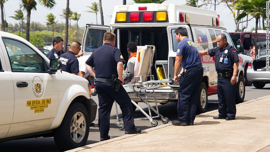 The boy who says he stowed away in the wheel well of a flight from California to Hawaii is loaded into an ambulance.