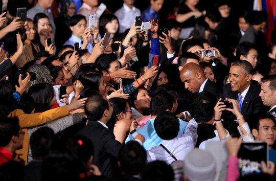 U.S. President Barack Obama, right, greets attendees after speaking at a town hall style event at the University of Malaya with participants in the Young Southeast Asian Leaders Initiative in Kuala Lumpur, Malaysia, Sunday, April 27, 2014. With the first visit to Malaysia by a U.S. president in nearly half a century, Obama holds economic and security talks with Malaysian Prime Minister Najib Razak, who leads a southeast Asian nation with an important role in Obamas efforts to forge deeper ties with the region. Photo: Lai Seng Sin, AP / AP