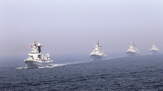 (FILE) Chinese missile destroyers navigate during the fleets review of the China-Russia joint naval exercise in the Yellow Sea April 26, 2012. (Reuters / China Daily)