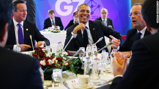 President Barack Obama laughs with British Prime Minister David Cameron, left, and French President Francois Hollande during a G7 session in Brussels, Belgium, on Thursday, June 5. Obamas travel agenda includes Poland, Belgium and France.