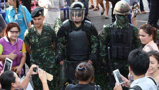 People take photos of Thai special forces officers during an event called