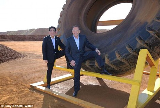 Cringe: Posted a snap of him and true friend Japanese leader Shinzo Abe posing in front of a giant tyre in Western Australias Pilbara region