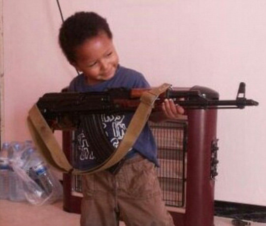 Disturbing: A Twitter post showing Dares four-year-old son grinning as he brandishes an AK-47 rifle