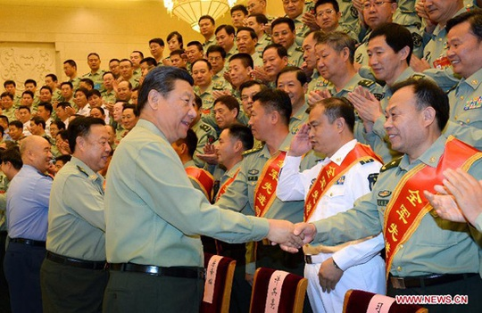 Chinese President Xi Jinping, also general secretary of the Communist Party of China (CPC) Central Committee and chairman of the Central Military Commission, shakes hands with delegates attending a meeting of chiefs of staff of the People