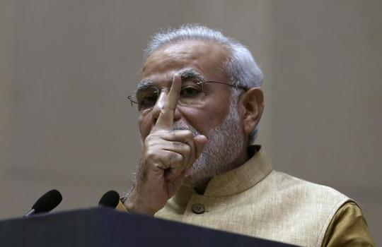 Prime Minister Narendra Modi gestures as he speaks during the launch of Make in India campaign in New Delhi September 25, 2014. REUTERS/Adnan Abidi