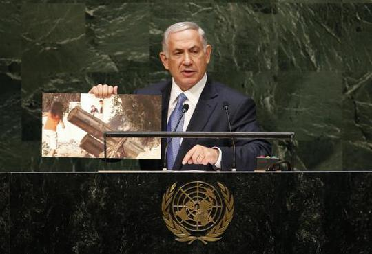 Israels Prime Minister Benjamin Netanyahu holds up a photograph as he addresses the 69th United Nations General Assembly at the U.N. headquarters in New York September 29, 2014. REUTERS-Mike Segar