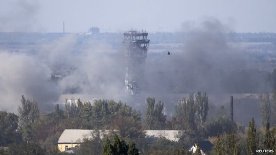 Smoke rises near the traffic control tower at Donetsk airport. Photo: 3 October 2014