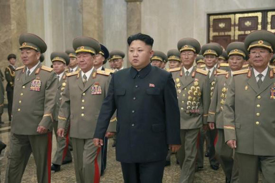 North Korean leader Kim Jong Un (4th R) visits the Kumsusan Palace of the Sun to pay tribute to founding President Kim Il Sung and former leader Kim Jong Il to mark the 61st anniversary of the victory of the Korean people in the Fatherland Liberation War, in this photo released by North Koreas Korean Central News Agency (KCNA) in Pyongyang July 27, 2014. REUTERS/KCNA