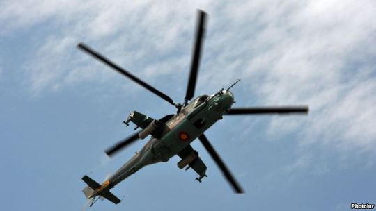 An Armenian Mi-24 combat helicopter flies near Yerevan. (file photo)