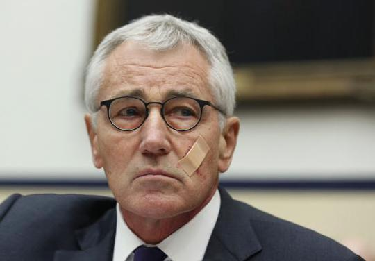 Secretary of Defense Chuck Hagel listens during his testimony at the House Armed Services Committee on Capitol Hill, November 13, 2014. REUTERS-Larry Downing