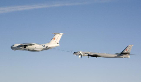 An undated handout photo provided by the Norwegian Army shows a Russian Tupolev Tu-95 strategic bomber refuelling from a Ilyushin IL-78 air-to-air refuelling tanker aircraft over an unknown location during a military exercise. . REUTERS-Norwegian NATO QRA Bodø-Handout