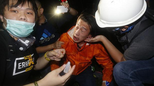 A pro-democracy protester is treated after police used pepper spray during a rally close to the government headquarters in Hong Kong, on Nov 30, 2014. -- PHOTO: REUTERS