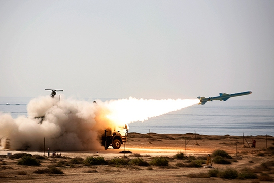 ARCHIVE PHOTO: An Iranian long-range shore-to-sea missile called Qader (Capable) is launched during Velayat-90 war game on Sea of Omans shore near the Strait of Hormuz in southern Iran (Reuters / Ebrahim Norouzi)