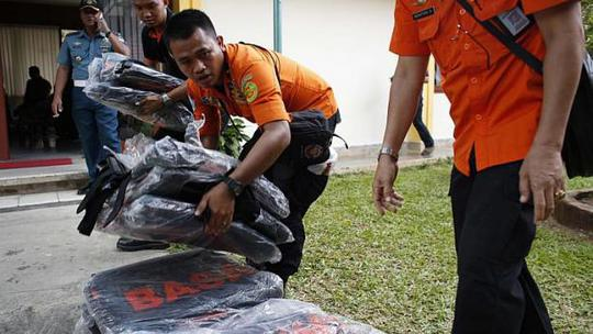 Search and rescue workers preparing to load body bags onto a flight to Kalimantan in Pangkal Pinang, Bangka on Dec 30, 2014. -- PHOTO: REUTERS