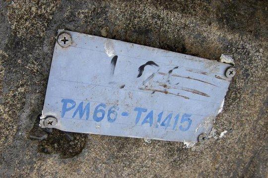 Không hiểu sao mộ của Nwe chỉ đánh số PM66-TA1415 trong khi cô được chôn với thẻ căn cước cá nhân. Ảnh: AP