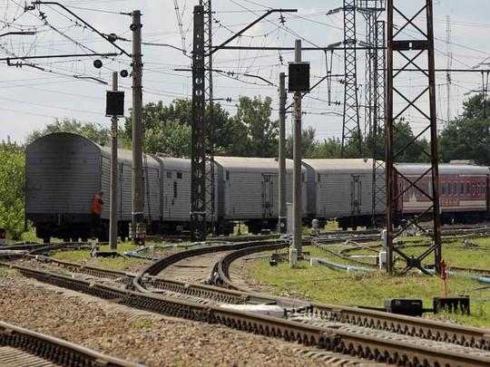 Chuyến tàu chở thi thể nạn nhân đến TP Kharkov - Ukraine hôm 22-7. Ảnh: AP