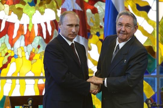 Thỏa thuận mở lại căn cứ nghe lén tại Cuba được ký kết trong chuyến thăm của Tổng thống Putin. Ảnh: RIA Novosti