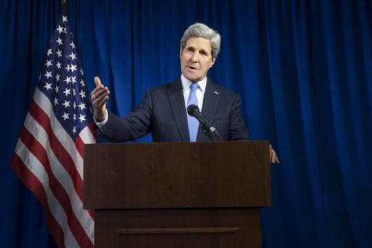 Ngoại trưởng Mỹ John Kerry phát biểu trong cuộc họp ở London hôm 16-12. Ảnh: Reuters