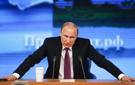 Tổng thống Nga Vladimir Putin nói sẽ không nước nào thành công trong việc đe dọa, ngăn chặn cô lập Nga vì vấn đề Crimea. Ảnh: Reuters