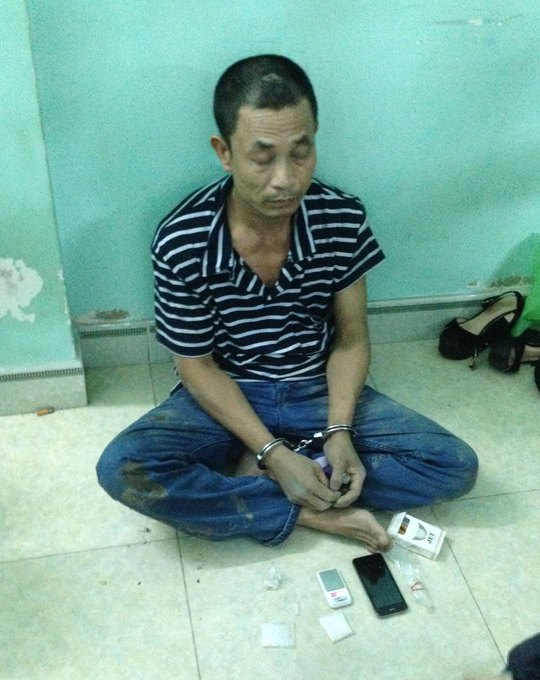 Bùi Quang Tùng tại cơ quan công an