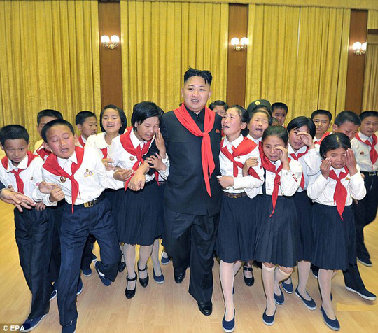 Crying children: Kim walks while flanked by sobbing members of the Korean Childrens Union (KCU) in 2012