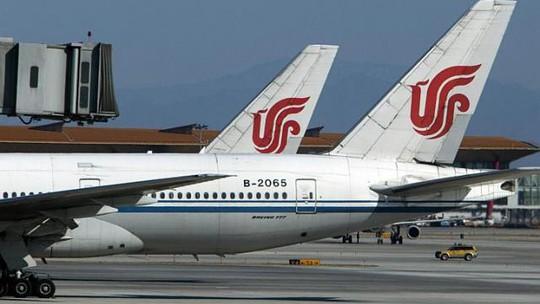 Máy bay của Air China đậu tại sân bay quốc tế Bắc Kinh. Ảnh: Bloomberg