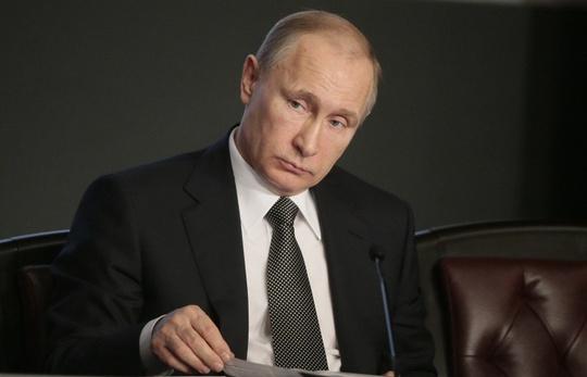 Nhà lãnh đạo Nga Vladimir Putin đã tự cắt giảm 10 % lương tháng của mình theo kế hoạch tối ưu hóa ngân sách ông đề ra trước đó. Ảnh: TASS