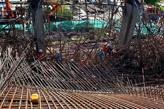 Hiện trường vụ sập khách sạn đang xây dựng ở TP Mandalay – Myanmar. Ảnh: EPA