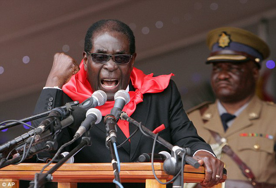 Leader: Preisdent of Zimbabwe Robert Mugabe, who is known for his brutal crusades against gay people, has mocked Americas decision to legalise gay marriage across all 50 states by proposing to Barack Obama
