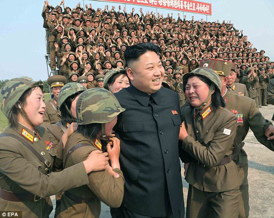Dear leader: Kim is surrounded by soldiers of a womens artillery unit in North Koreas southeastern province of Kangwon